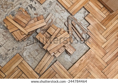 Damaged wooden floor -Ruined flooring from moisture and water - stock photo