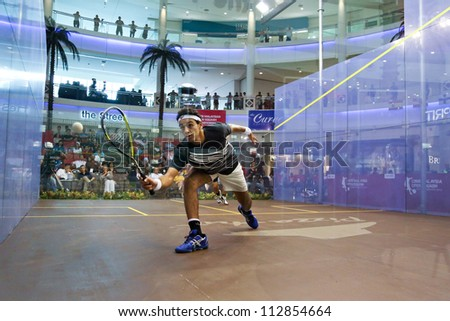 DAMANSARA - SEP 14: Mohamed El Shorbagy plays a return in front court in the men's semi-final of the CIMB Malaysian Open Squash Championships 2012 held in Damansara, Malaysia on September 14, 2012.