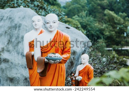 DAMBULLA, SRI LANKA - January 2015: Golden temple Dambulla.  The largest and best-preserved cave temple complex in Sri Lanka. 153 Buddha statues . Monument declared a World Heritage Site by Unesco. - stock photo