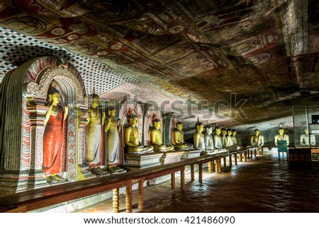 DAMBULLA, SRI LANKA - MARCH 26, 2016: Cave in Dambulla, Sri Lanka. Cave temple has five caves under a vast overhanging rock and dates back to the first century BC.