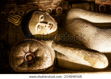 DAMBULLA, SRI LANKA - March 27, 2014: Cave temple. It has five caves under a vast overhanging rock and dates back to the first century BC. Dambulla Rock Temple is a Unesco World Heritage Site.  - stock photo