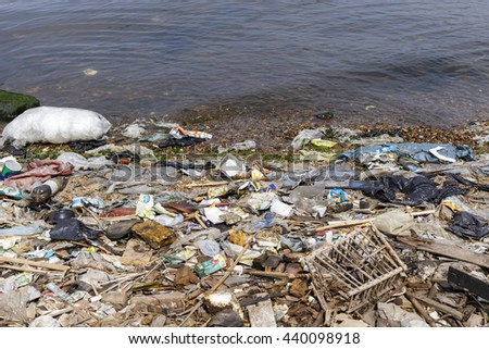 Damietta, Egypt - May 13 ,2016: rubbish polluted river beach.