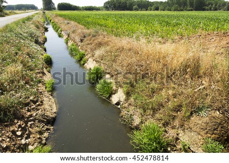 dams and canals for crops irrigate in the Castilla fields, Spain - stock photo