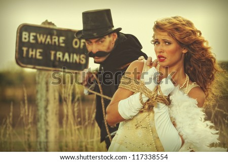 Damsel in distress woman tied up by villain - stock photo