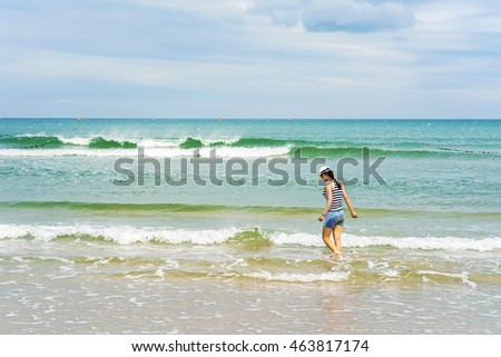 Danang, Vietnam - February 20, 2016: Young girl at the China Beach, in Danang in Vietnam. No face