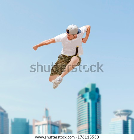 dance and fitness concept - male dancer jumping in the air - stock photo