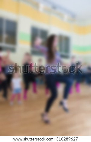 Dance class for women at fitness centre abstract blur background