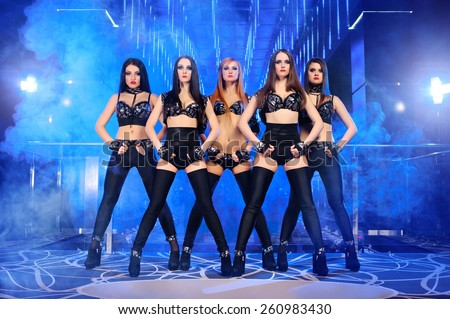 dance group sexy girls in suits, disco - stock photo