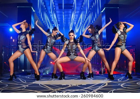 dance group sexy girls in suits, disco, - stock photo