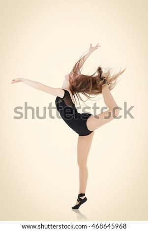 Dance jump. Beautiful caucasian woman dancer isolated.