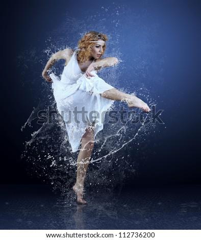 Dance of ballerine around water splashes and drops - stock photo