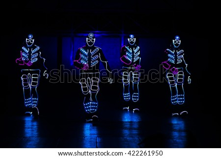 dance team in costumes of the LEDs - stock photo