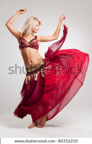 Dance with passion, studio isolated shot over white background - stock photo