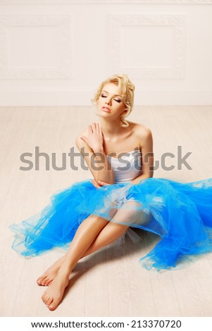 Dancer, ballerina. Cute woman looks like a doll in a sweet interior. Young pretty smiling girl - stock photo