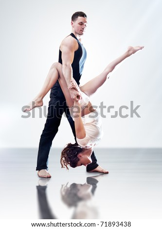 Dancer couple. On bright background. - stock photo