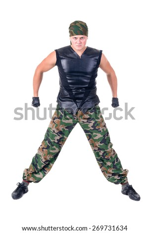 dancer dressed soldier showing some movements against isolated white background - stock photo