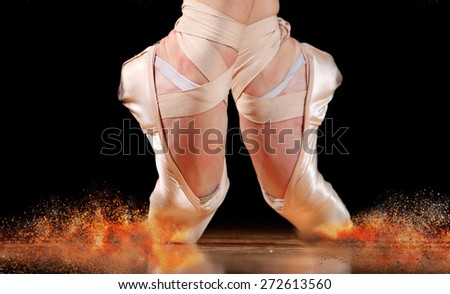 dancer in ballet shoes dancing in Pointe on a wooden floor - stock photo