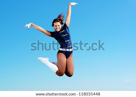 dancer jumping on a background of blue sky