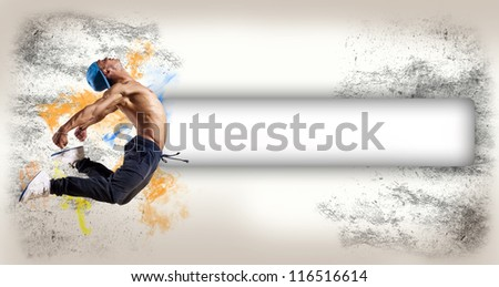 Dancer jumping on the background space for text - stock photo