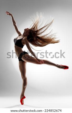 dancer posing on a studio background - stock photo