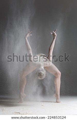 dancer posing on a studio background - stock photo