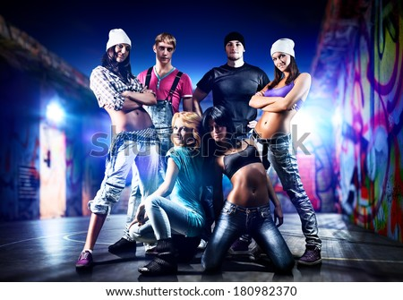 Dancer team on night urban background. - stock photo