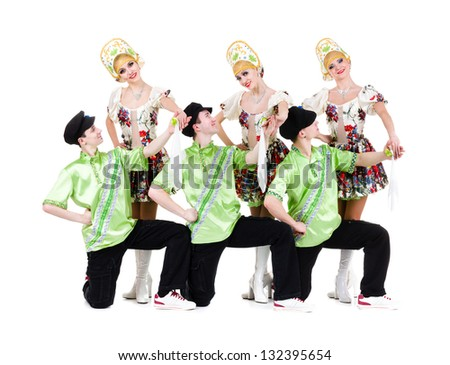 Dancer team wearing a folk ukrainian costumes dancing.  Isolated on white background in full length.