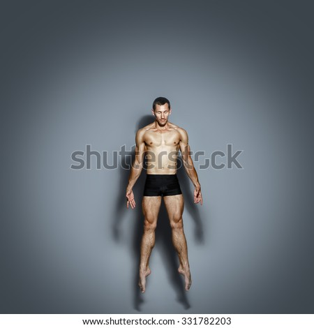 Dancer with a naked torso in a jump