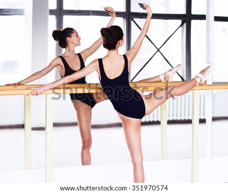Dancer woman take a picture yourself photo near mirror wall - stock photo