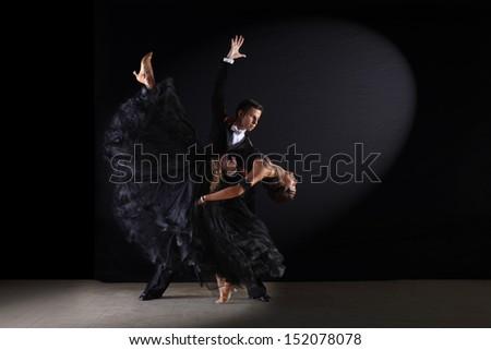 dancers in ballroom against black background - stock photo