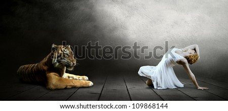 Dancers in posing and tiger - stock photo