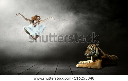 Dancers in posing and tygr - stock photo