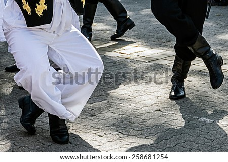 Dancers who perform, with the legs, specific movements of a Serbian dance. - stock photo