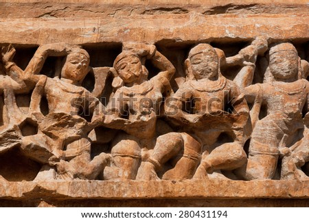 Dances of women on the carved stone wall of historical hindu temple, India - stock photo