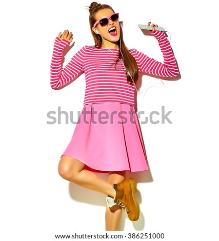dancing beautiful happy cute smiling sexy brunette woman girl in casual colorful pink summer clothes with red lips isolated on white listening to music  - stock photo