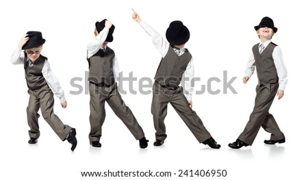 Dancing boy in suit and hat isolated on white - stock photo