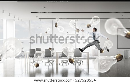 Dancing businessman in office room