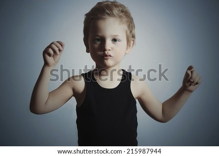 Dancing Child. Funny Little Boy.Handsome Boy try to dance. Blue background - stock photo
