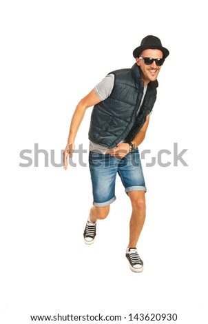 Dancing cool rapper and smiling isolated on white background - stock photo