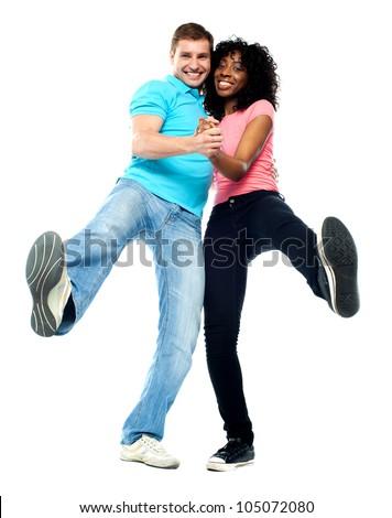Dancing couple having fun. Showing legs to camera - stock photo