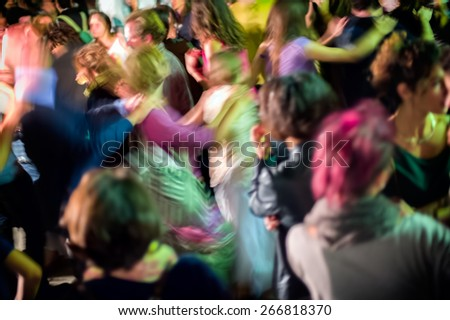 Dancing crowd at night, abstract motion blur photo. - stock photo
