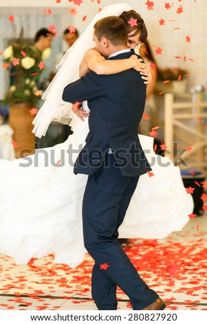 dancing cute couple  on the  background restaurant - stock photo