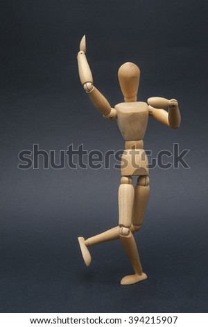 dancing dummy/Person represented by a wooden dummy while performing a dancing figure.