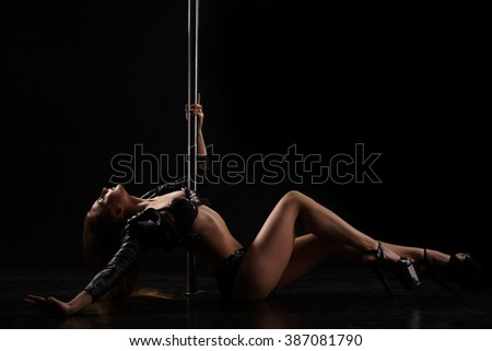 Dancing for adults. Image of sexy pole dancer - stock photo