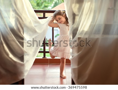 Dancing girl in the doorway - stock photo