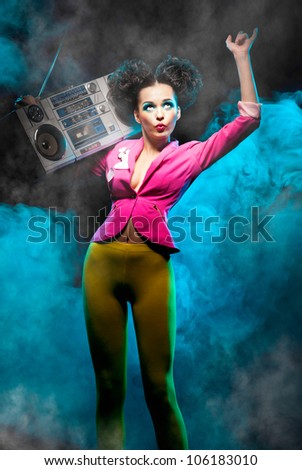 Dancing girl with a tape recorder - stock photo
