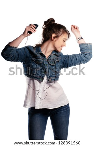 Dancing girl with earphones in denim isolated on white
