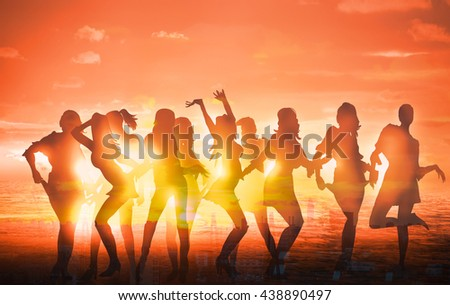 Dancing girls silhouettes against of sunset at the beach
