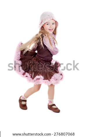 Dancing happy little girl in pink tutu skirt and panama hat isolated on a white background - stock photo