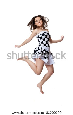 Dancing in black and white polka dot dress isolated on a white background - stock photo